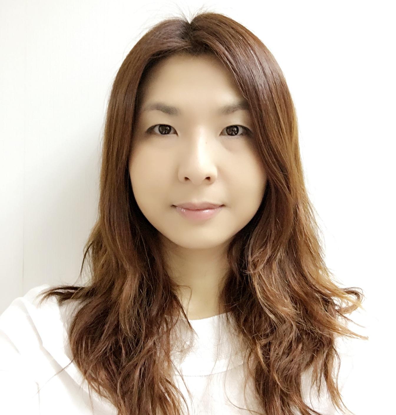 Ms Justina Ho